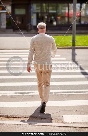 senior man walking along city crosswalk stock photo, leisure and people concept - senior man walking along summer city crosswalk by Syda Productions