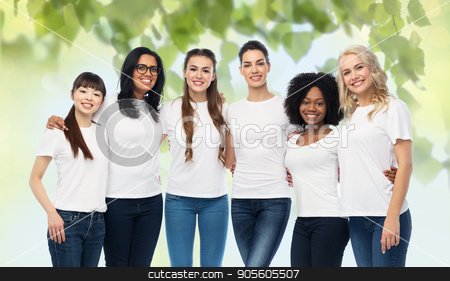 international group of volunteer women hugging stock photo, diversity, ecology and people concept - international group of happy smiling volunteer women in white blank t-shirts hugging over green natural background by Syda Productions