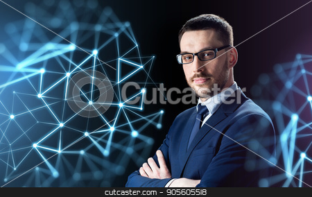 businessman in glasses over black stock photo, business, people and technology concept - businessman in glasses over black background with low poly shape projection by Syda Productions