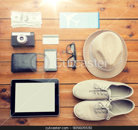 close up of gadgets and traveler personal stuff stock photo, vacation, travel, tourism, technology and objects concept - close up of gadgets and traveler personal stuff by Syda Productions