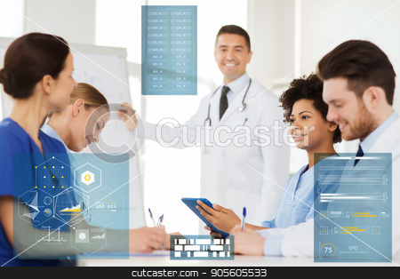 group of doctors on conference at hospital stock photo, medicine, healthcare, technology and people concept - group of happy doctors at conference or presentation at hospital by Syda Productions