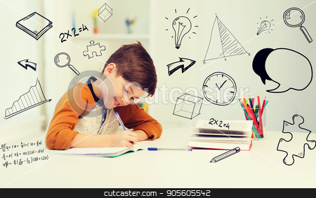 smiling student boy writing to notebook at home stock photo, education, childhood, people, homework and school concept - smiling student boy with book writing to notebook at home over mathematical doodles by Syda Productions