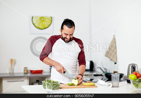 man with blender and fruit cooking at home kitchen stock photo, healthy eating, vegetarian food, diet and people concept - happy young man with blender and fruits cooking at home kitchen by Syda Productions