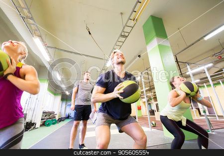 group of people with medicine ball training in gym stock photo, fitness, sport and exercising concept - group of people with medicine balls training in gym and coach writing to clipboard by Syda Productions