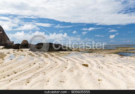rocks on seychelles island beach in indian ocean stock photo, travel, landscape and nature concept - rocks on seychelles island beach in indian ocean by Syda Productions