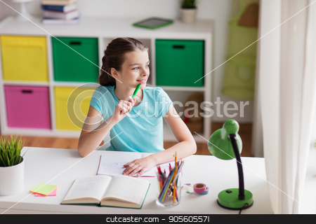 happy girl with book writing to notebook at home stock photo, people, children, education and learning concept - happy girl with book and notebook looking through window at home by Syda Productions