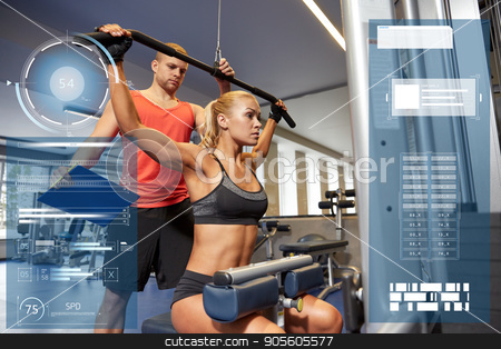 man and woman flexing muscles on gym machine stock photo, sport, fitness, exercising and people concept - young woman flexing muscles on gym machine and personal trainer with clipboard over virtual charts by Syda Productions