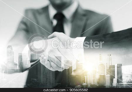 two businessmen shaking hands at office stock photo, business, cooperation, partnership and people concept - two businessmen shaking hands at office over city buildings and double exposure effect by Syda Productions