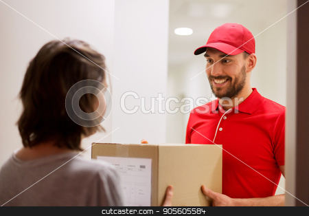 happy delivery man giving parcel box to customer stock photo, delivery, mail, people and shipping concept - happy man delivering parcel box to customer home by Syda Productions