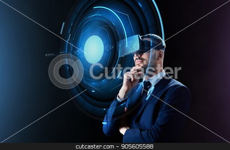 businessman in virtual reality headset stock photo, business, people, augmented reality and modern technology concept - businessman in virtual headset looking at projection over black background by Syda Productions