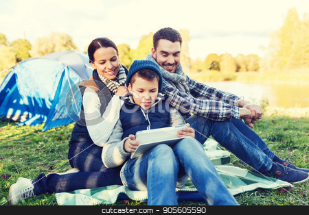 happy family with tablet pc and tent at camp site stock photo, camping, tourism, hike, technology and people concept - happy family with tablet pc computer and tent at camp site by Syda Productions