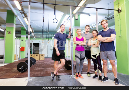 group of happy friends in gym stock photo, fitness, sport and people concept - group of happy friends in gym by Syda Productions