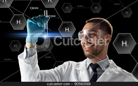 smiling scientist in goggles with test tube stock photo, science, future technology and chemistry concept - young smiling scientist in goggles with test tube and virtual chemical formula projection over black background by Syda Productions