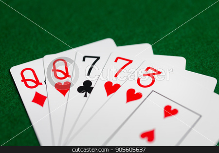 poker hand of playing cards on green casino cloth stock photo, casino, gambling, games of chance, hazard and entertainment concept - poker hand of playing cards on green cloth by Syda Productions