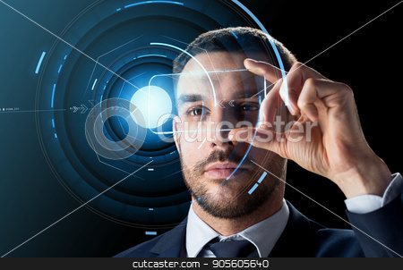 businessman with transparent smartphone stock photo, business, augmented reality and future technology concept - businessman in suit working with transparent smartphone and hologram over black background by Syda Productions