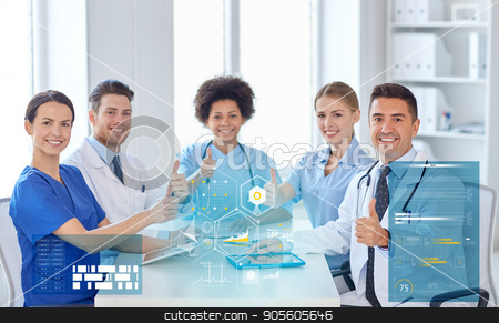 group of happy doctors meeting at hospital office stock photo, hospital, profession, people and medicine concept - group of happy doctors meeting at medical office by Syda Productions