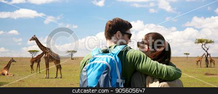 happy couple with backpacks traveling stock photo, travel, tourism and people concept - happy couple with backpacks hugging over african savannah and giraffes background by Syda Productions