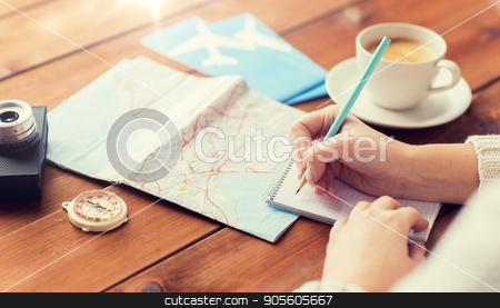 close up of traveler hands with notepad and pencil stock photo, vacation, tourism, travel, destination and people concept - close up of traveler hands with blank notepad and pencil by Syda Productions