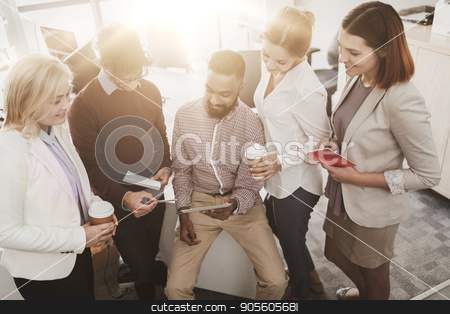business team with tablet pc and coffee at office stock photo, business, technology, break and people concept - happy creative team with tablet pc computer drinking coffee and talking at office by Syda Productions