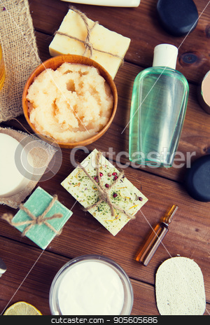 close up of body care cosmetic products on wood stock photo, beauty, spa, therapy, natural cosmetics and wellness concept - close up of body care cosmetic products on wood by Syda Productions