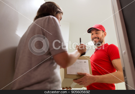 deliveryman and customer with parcel boxes at home stock photo, delivery, mail, people and shipping concept - happy man with clipboard delivering parcel boxes to customer signing form at home by Syda Productions