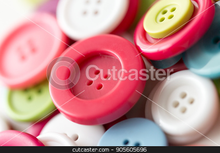 close up of sewing buttons stock photo, needlework and tailoring concept - sewing buttons by Syda Productions