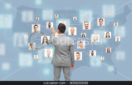 businessman touching virtual screen with contacts stock photo, business, people, communication, cooperation and technology concept - businessman touching virtual screen with contacts icons and usa or america map over blue on background by Syda Productions
