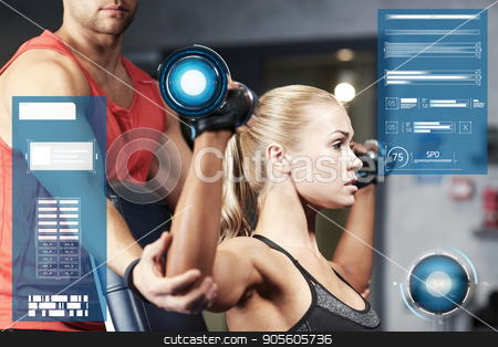 man and woman with dumbbells in gym stock photo, sport, fitness, bodybuilding, exercising and people concept - man and woman with dumbbells flexing muscles in gym over virtual charts by Syda Productions