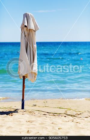 Folded beach umbrella stock photo, Selective focus. by Veresovich