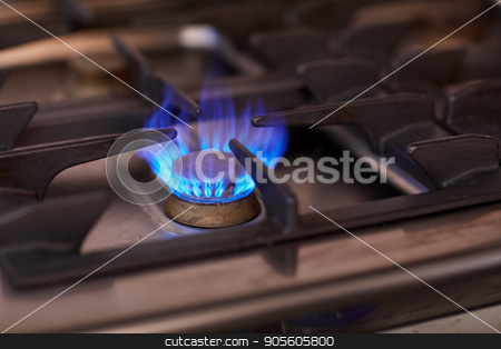 burning gas stove flame stock photo, kitchen and cooking concept - burning gas stove flame by Syda Productions