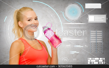 smiling sporty woman with water bottle stock photo, sport, fitness and people - happy sporty woman drinking water from bottle over gray concrete background by Syda Productions