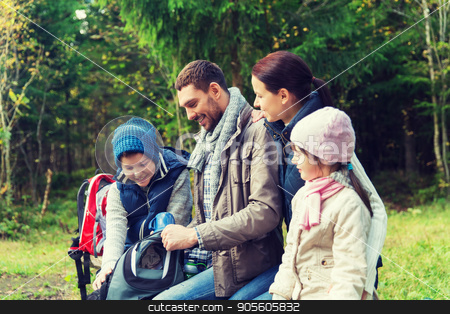 happy family with backpacks and thermos at camp stock photo, camping, travel, tourism, hike and people concept - happy family with backpacks and thermos at camp by Syda Productions