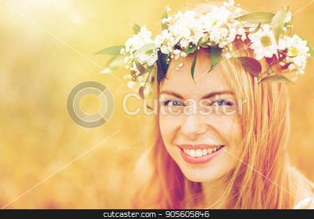 happy woman in wreath of flowers stock photo, nature, summer holidays, vacation and people concept - face of happy woman in wreath of flowers by Syda Productions