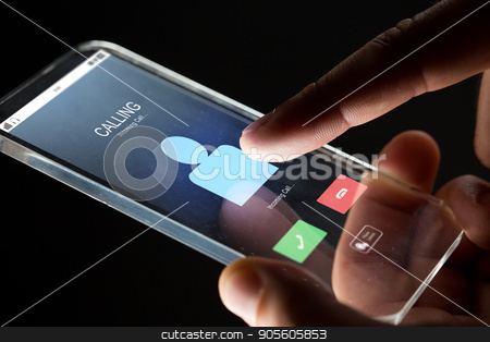 close up of hand with incoming call on smartphone stock photo, business, people and future technology concept - close up of businessman hand with incoming call on transparent smartphone over black background by Syda Productions