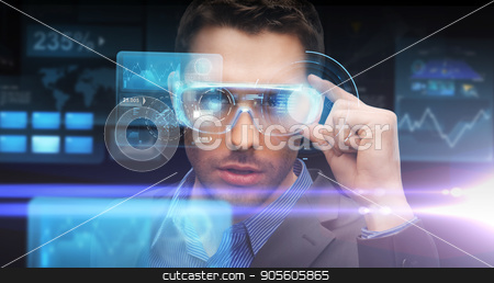 businessman in virtual reality or 3d glasses stock photo, augmented reality, technology, business and people concept -businessman in virtual glasses looking at screen projections over dark background by Syda Productions