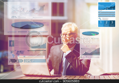senior businessman with laptop at city street cafe stock photo, business, statistics and people concept - senior businessman with laptop computer at city street cafe with charts by Syda Productions