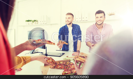 happy business team eating pizza in office stock photo, business, food, lunch and people concept - happy international business team eating pizza in office by Syda Productions