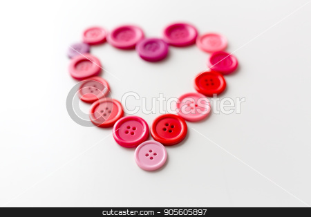 heart shape of sewing buttons stock photo, love, valentines day, needlework and tailoring concept - heart shape of sewing buttons by Syda Productions