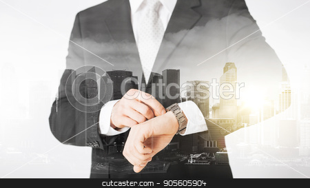 close up of businessman with wristwatch stock photo, people, business and time concept - close up of businessman with wristwatch over city with double exposure by Syda Productions