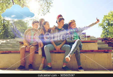 happy teenage students taking selfie by smartphone stock photo, cloud computing, technology and people concept - group of happy teenage students or friends taking selfie by smartphone outdoors by Syda Productions