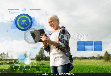 senior woman with tablet pc computer at county stock photo, organic farming, agriculture, technology, old age and people concept - happy senior woman with tablet pc computer at county or farm by Syda Productions