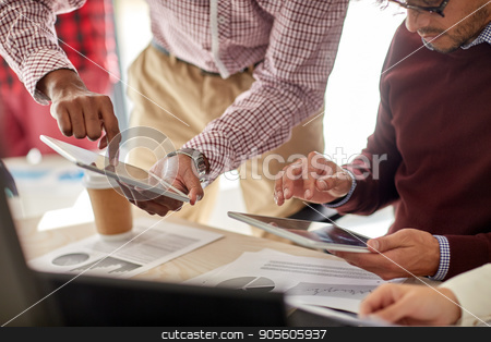 businessmen with tablet pc and charts at office stock photo, business, technology and people concept - businessmen with tablet pc computer and charts at office by Syda Productions