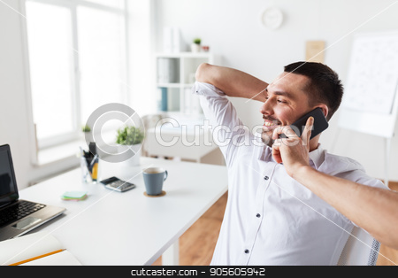 businessman calling on smartphone at office stock photo, business, people, communication and technology concept - businessman calling on smartphone at office by Syda Productions