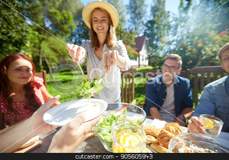 happy friends having dinner at summer garden party stock photo, leisure, holidays, eating, people and food concept - happy friends having dinner at summer garden party by Syda Productions