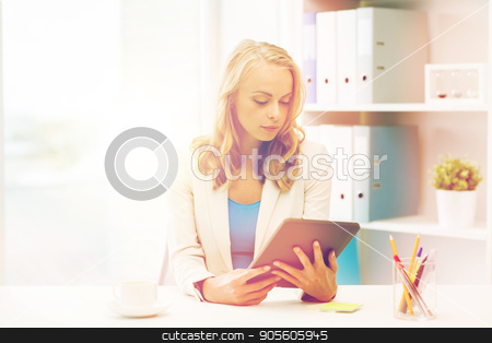 businesswoman or student with tablet pc at office stock photo, office, business, education, technology and people concept - businesswoman or student with tablet pc computer sitting at table by Syda Productions