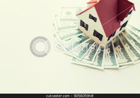 close up of home or house model and money stock photo, building, mortgage, investment, real estate and property concept - close up of home or house model and money by Syda Productions