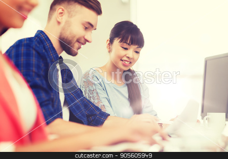 happy creative team or students working at office stock photo, business, startup, education and people concept - happy creative team or students working at office by Syda Productions