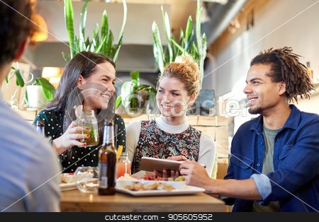 friends with tablet pc, drinks and food at bar stock photo, technology, people and friendship concept - happy friends with tablet pc computer, drinks and food at bar by Syda Productions