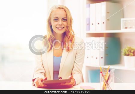 businesswoman or student with tablet pc at office stock photo, office, business, education, technology and people concept - smiling businesswoman or student with tablet pc computer sitting at table by Syda Productions