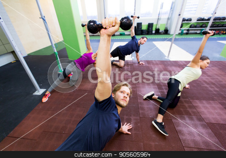 group of people working out with dumbbells stock photo, fitness, sport and training concept - group of people working out with dumbbells in gym by Syda Productions